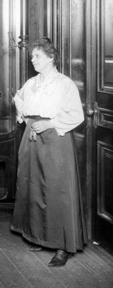 Housekeeper in the early 1900s holding keychain