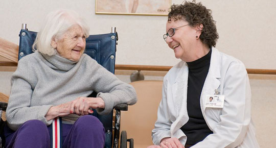 Patient and caregiver in rehab center