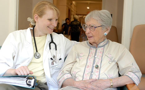 Nurse Practitioner consulting with patient