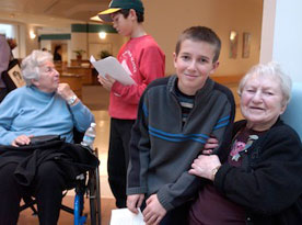 two students and two residents at an intergenerational program