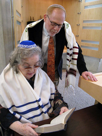 Rebekah Finer and Rabbi Marder in the synagogue