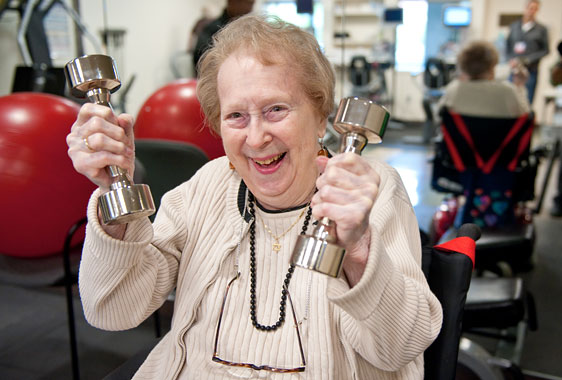 Nanette Goldman lifting weights in the Fitness Center