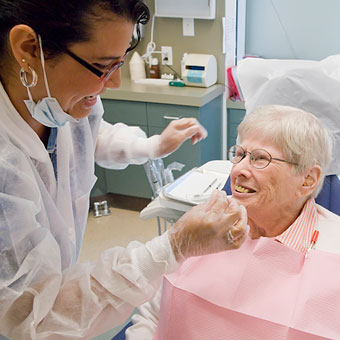Dentists instructs patient in the Dental Clinic at Jewish Home