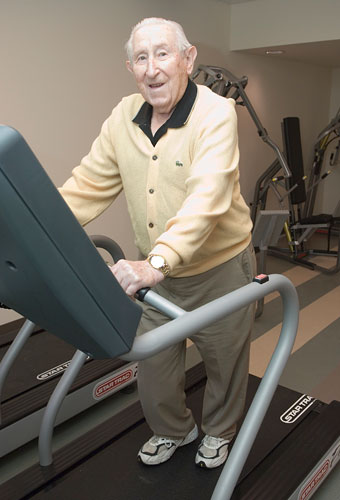 resident using treadmill in the fitness center