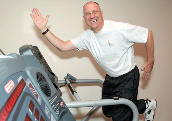 Jim Weslow, Director of Rehabilitation Services, on a treadmill in the fitness center